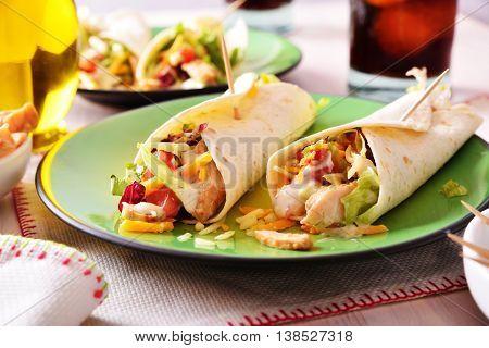 Two Chicken Fajitas On Green Plate