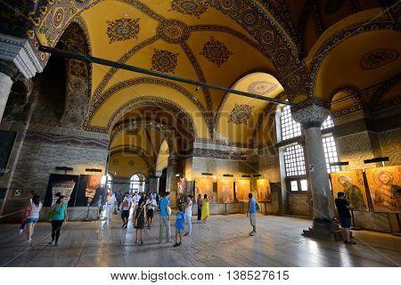 ISTANBUL - AUGUST 7: Tourists visiting the Hagia Sophia, August 7, 2013 in Istanbul, Turkey. Hagia Sophia is the greatest monument of Byzantine Culture in Istanbul, Turkey.