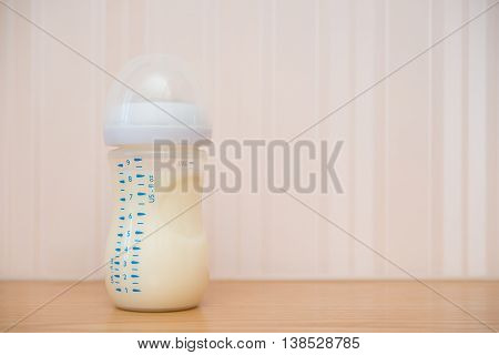 baby bottle of powdered milk at home with copy space