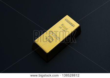 piece of gold bar on a black background