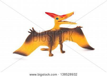 side view orange pterosaurs toy on a white background