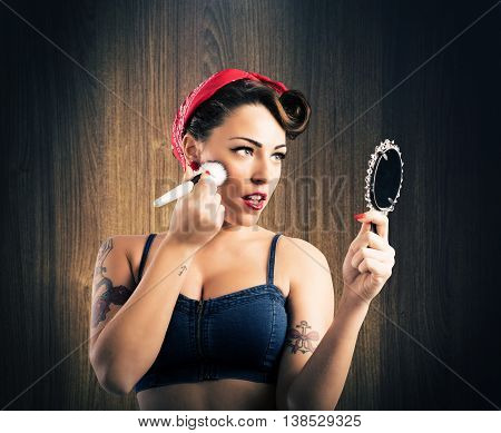 Pin-up girl make-up looking to a mirror
