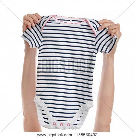 Female hands holding baby bodysuit on white background