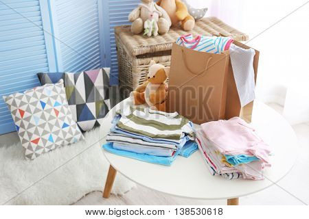 Piles of baby clothes, close up