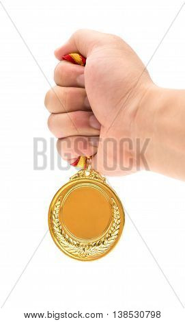 man holding a gold medal with hand
