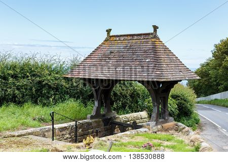 LYTHE ENGLAND - JULY 12: The lychgate at the Church Of St Oswald. In Lythe North Yorkshire England. On 12th July 2016.