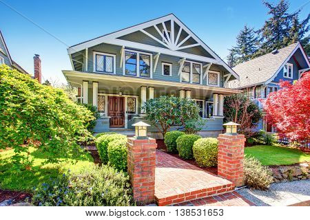 Large Luxury Blue Craftsman Classic American House Exterior.