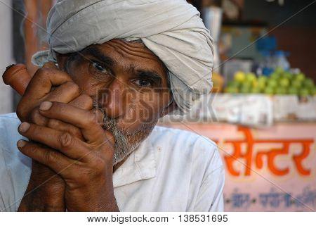 Jaipur, India - february 22, 2006: Rickshaw smoking on a city street
