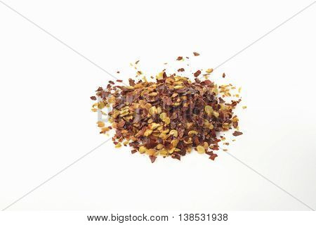 Red Chili Flakes on White Background Shot in Studio