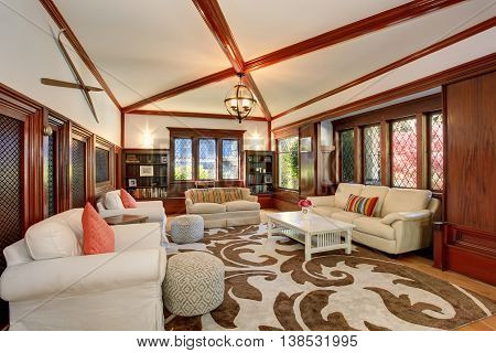 Luxury Living Room Interior With Built-in Furniture, Vaulted Ceiling And Beams