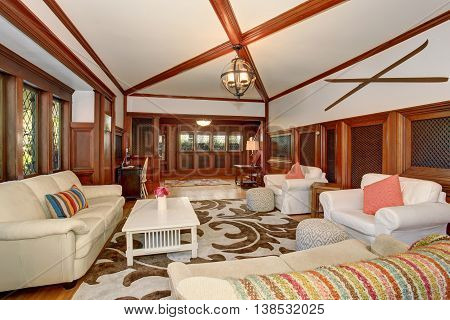 Luxury Living Room Interior With Brown Wooden Trimmings And Vaulted Ceiling With Beams