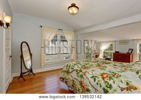 Cozy Bedroom Interior With Vaulted Ceiling And Hardwood Floor.