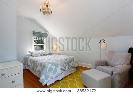 Cozy Attic Bedroom With White Walls And Yellow Rug.