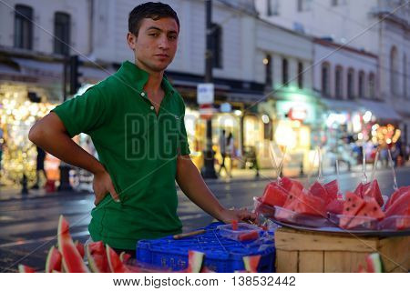 ISTANBUL - AUGUST 7: Unknown man trades watermelon in a street, August 7, 2013 in Istanbul, Turkey. Istanbul is the world's fifth-most-popular tourist destination.