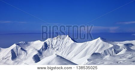Panoramic View On Snow Mountains And Blue Sky