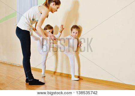 Trainer And Two Little Girls