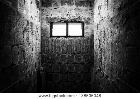 Light through window in old restroom with black and white color concept.