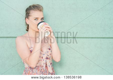 Pretty Girl Drinking From Takeaway Coffee Cup