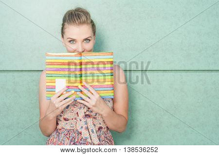 Beautiful Lady Holding Diary And Covering Her Mouth