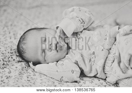 sweet newborn girl is sleeping at the home