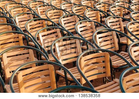 Wooden chairs. Empty stools without people. Concept photo - absence of audience.
