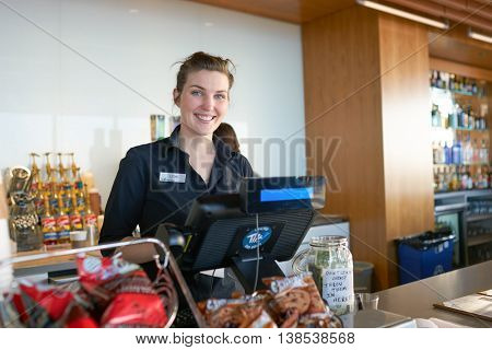 CHICAGO, IL - CIRCA MARCH, 2016: indoor portrait of barista in cafe at John Hancock Center's observatory. The John Hancock Center is a supertall skyscraper at 875 North Michigan Avenue, Chicago.