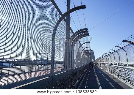 The walkway beside bridge for crossing the river