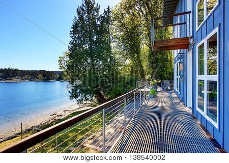 Large Unfurnished Porch Of Luxury House With View Of The Lake.