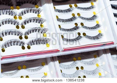 Close-up view of black stylish false eyelashes