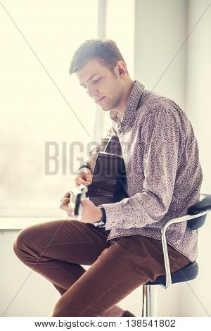 Handsome Smiling Guitarist Play Music