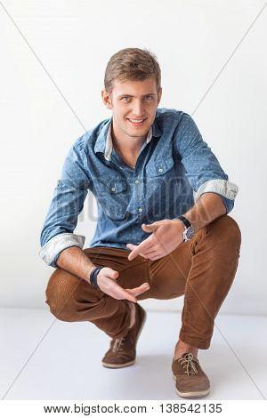 Handsome Man Sitting On The Floor