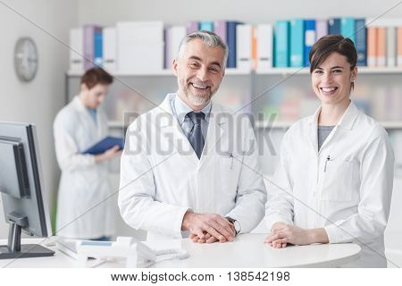 Doctor At The Reception Desk With His Assistant