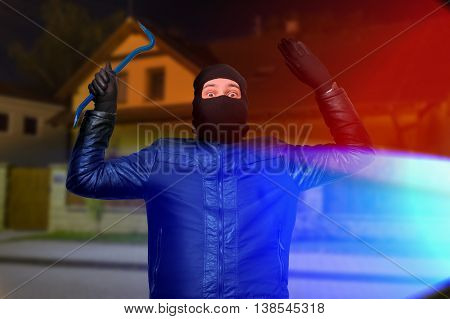 Police Lights And Masked Burglar Or Thief With Balaclava Is Arre