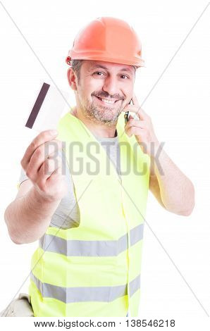 Constructor Talking On Phone And Holding Credit Card