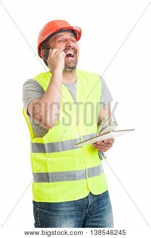 Joyful Constructor Talking On Cellphone And Laughing