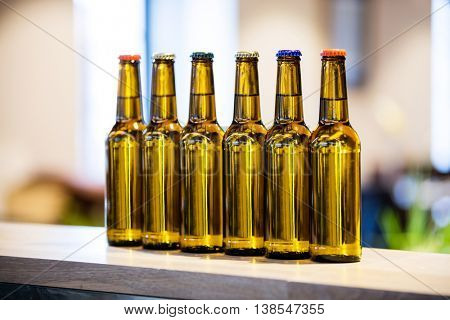 Close-up of arranged beer bottles on the bar counter at restaurant