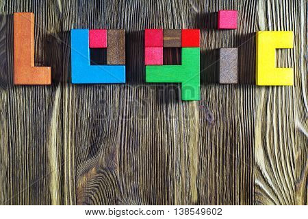 The word on the logic of multicoloured wooden blocks on a wooden background