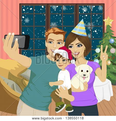 Smiling mother, father and little son making selfie with camera over living room and christmas tree background. Family, holidays, technology and people