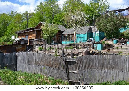 Old houses with poor fence in the countryside