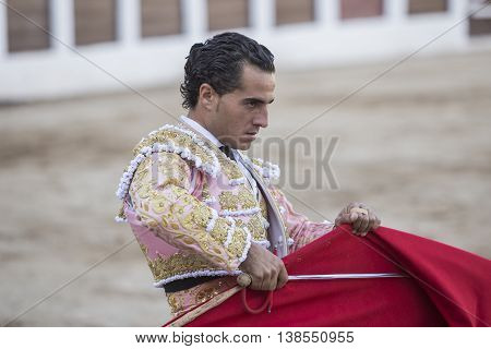 Linares Spain - August 29 2014: The Spanish Bullfighter Ivan Fandiño bullfighting with the crutch in the Bullring of Linares Spain