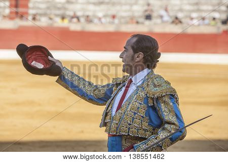 Baeza SPAIN - august 15 2009: The Spanish Bullfighter Luis Francisco Espla greeting the public with its cap in the hand in gratitude to its bullfight in the Bullring of Baeza Spain