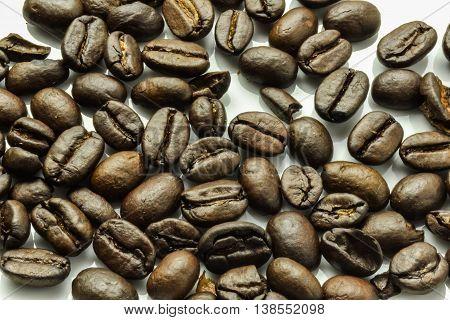 Coffee beans white background roasted. Beautiful photo
