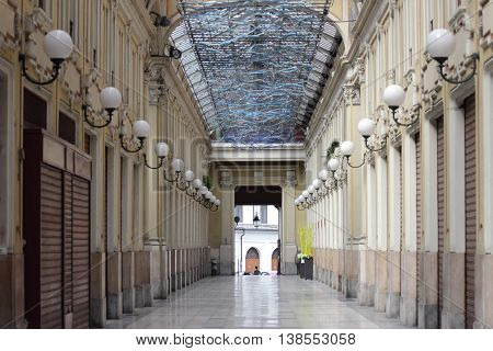 TURIN ITALY - JUNE 5 2016: The Galleria Umberto I was built on the site of the Hospital of the Mauritian Order that closed in 1890.The glass-covered walkways are separated in a