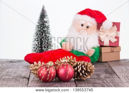 Christmas baubles, Santa Claus toy and pine cones