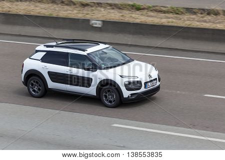 FRANKFURT GERMANY - JULY 12 2016: Citroen Cactus compact crossover car driving on the highway in Germany