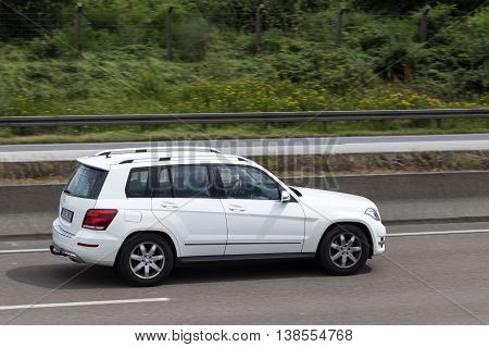 FRANKFURT GERMANY - JULY 12 2016: Mercedes Benz GLK luxury SUV driving on the highway in Germany