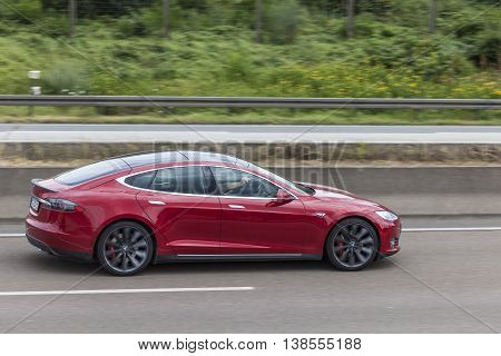 FRANKFURT GERMANY - JULY 12 2016: Tesla Model S luxury electric sedan on the highway in Germany