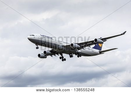 FRANKFURT GERMANY - JULY 12 2016: Airbus A340-300 from the Lufthansa airline approaching Frankfurt Main international airport