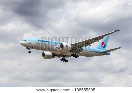 FRANKFURT GERMANY - JULY 12 2016: Korean Air Boeing 777F cargo aircraft approaching Frankfurt Main international airport
