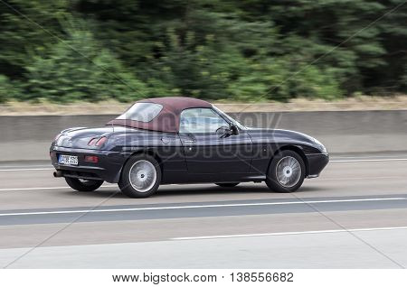 FRANKFURT GERMANY - JULY 12 2016: Fiat Barchetta convertible driving on the highway in Germany